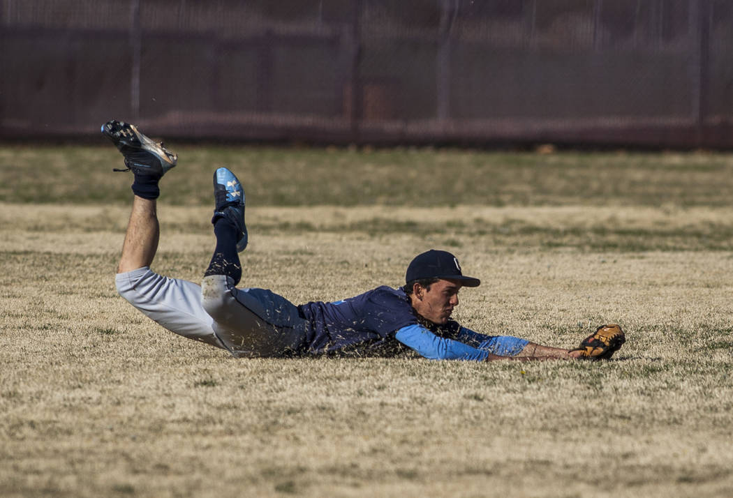 Centennial outfielder Brian Wyche makes a diving catch in the bottom of the second inning against Faith Lutheran at Faith Lutheran High School in Las Vegas on Thursday, March 15, 2018. Centennial  ...