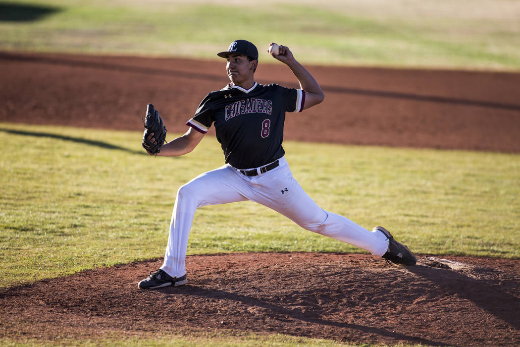 Faith Lutheran pitcher Jacob Ortega pitches against Centennial in the top of the ninth inning at Faith Lutheran High School in Las Vegas on Thursday, March 15, 2018. Centennial won 4-3 in the 10th ...