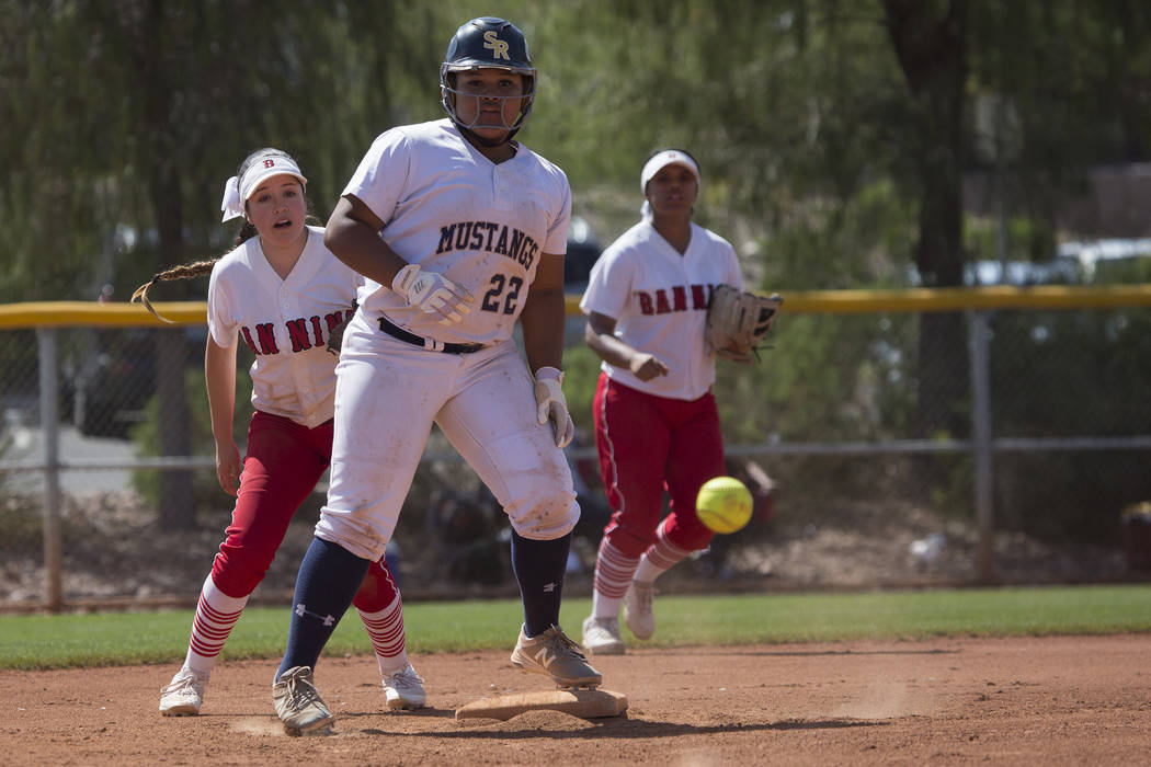 Shadow Ridge sophomore Alyssa Stanley safely makes it to second base as Banning misses a pass at Majestic Park in part of the Spring Jamboree softball tournament on Saturday, April 15, 2017, in La ...