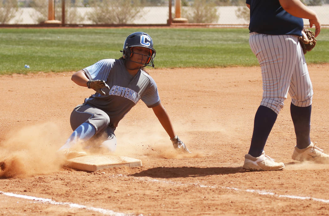 Centennial's shortstop Kiana Tate (4) slides safely unto third base against North High School in the third inning during the Spring Jamboree 2018 at Majestic Park in Las Vegas on Thursday, March 2 ...
