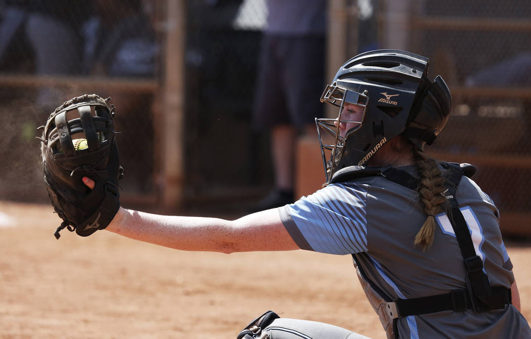 Centennial's catcher Jillian Bartley (07) catches a throw against North High School during the Spring Jamboree 2018 at Majestic Park in Las Vegas on Thursday, March 29, 2018. Centennial won 6-5. A ...