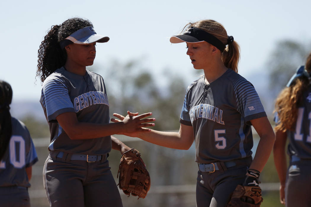 Centennial's Kiana Tate (4) and Seanna Simpson (5) congratulate each other after a play against North High School in the first inning during the Spring Jamboree 2018 at Majestic Park in Las Vegas  ...