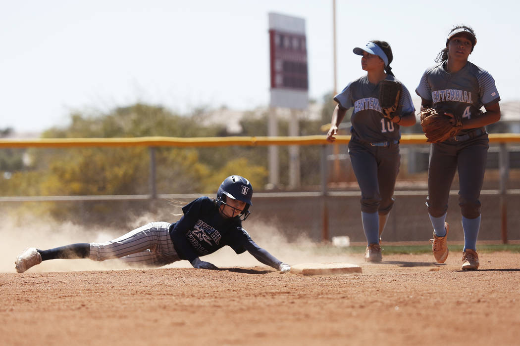 NorthÕs Cynthia Guerrero (28) slides safely into second base against Centennial High School in the second inning during the Spring Jamboree 2018 at Majestic Park in Las Vegas on Thursday, Mar ...