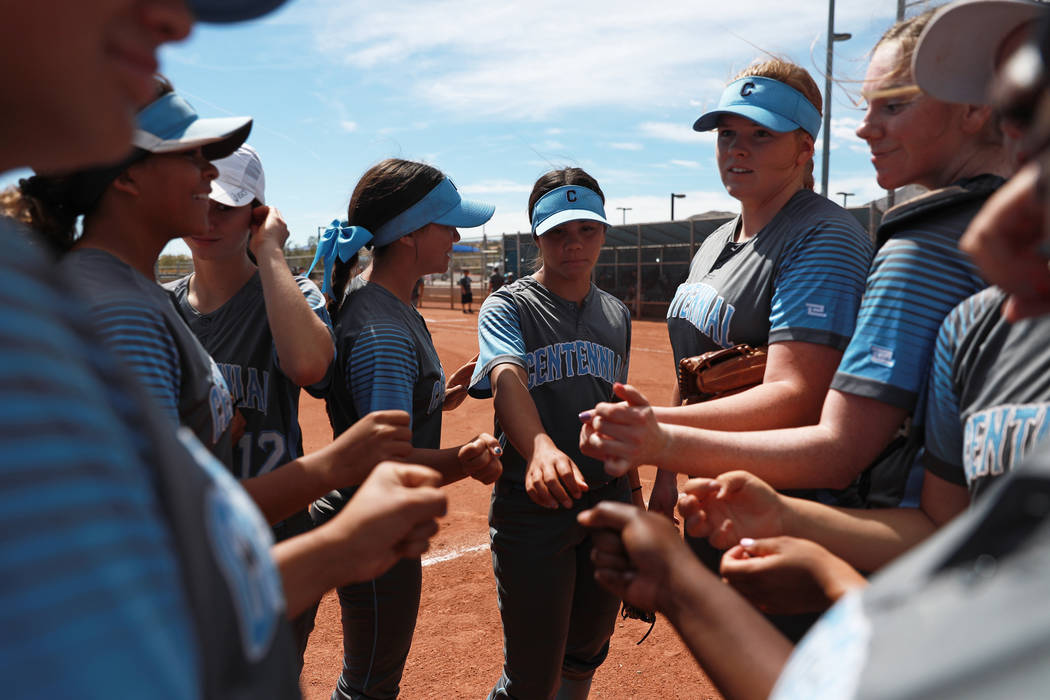 Centennial High School's softball team gathers for a pep talk during the Spring Jamboree 2018 at Majestic Park in Las Vegas on Thursday, March 29, 2018. Centennial won 6-5. Andrea Cornejo Las Vega ...