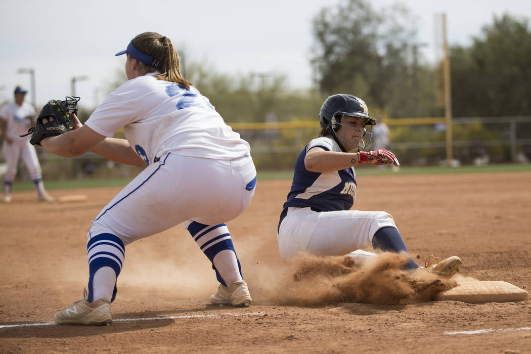 Shadow Ridge's Shea Clements (4) slides to third base safely against El Camino Real during the softball Spring Jamboree seventh-place game at Majestic Park in Las Vegas, Saturday, March 31, 2018.  ...