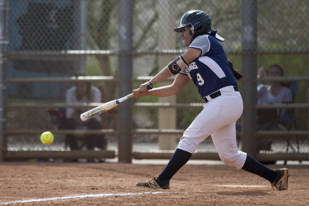 Shadow Ridge's Mariah Castellaonos (9) connects with the ball for a base hit against El Camino Real during the softball Spring Jamboree seventh-place game at Majestic Park in Las Vegas, Saturday,  ...