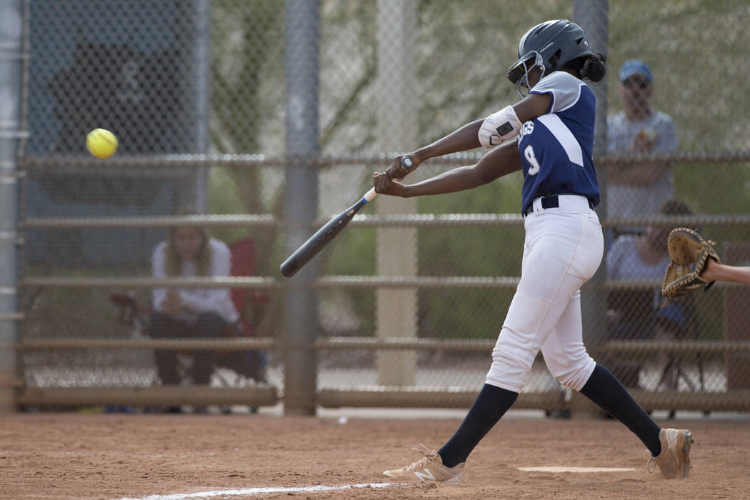 Shadow Ridge's Jasmine Martin (8) connects for a base hit against El Camino Real during the softball Spring Jamboree seventh-place game at Majestic Park in Las Vegas, Saturday, March 31, 2018. Eri ...