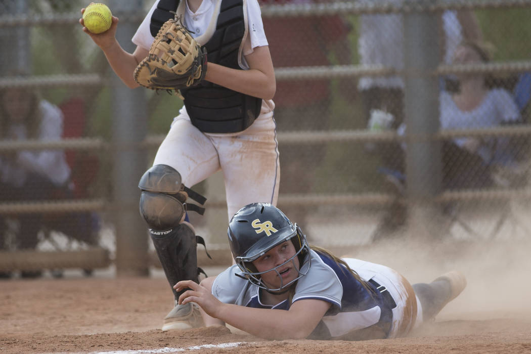 Shadow Ridge's Tori Nichols (18) slides home late for an out against El Camino Real during the softball Spring Jamboree seventh-place game at Majestic Park in Las Vegas, Saturday, March 31, 2018.  ...