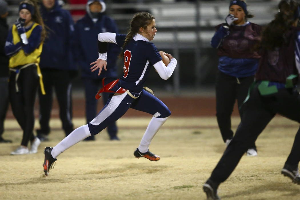 Coronado's Caitlin Shannon (9) runs the ball against Shadow Ridge during the Class 4A state flag football championship game at Cimarron-Memorial High School in Las Vegas on Thursday, Feb. 22, 2018 ...