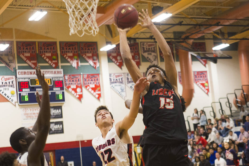 Liberty High School's Cameron Burist (15) attempts a basket against Coronado High School's Patrick Simms (22) at Coronado High School in Henderson, Wednesday, Feb. 7, 2018. Liberty won 69-61. Rach ...