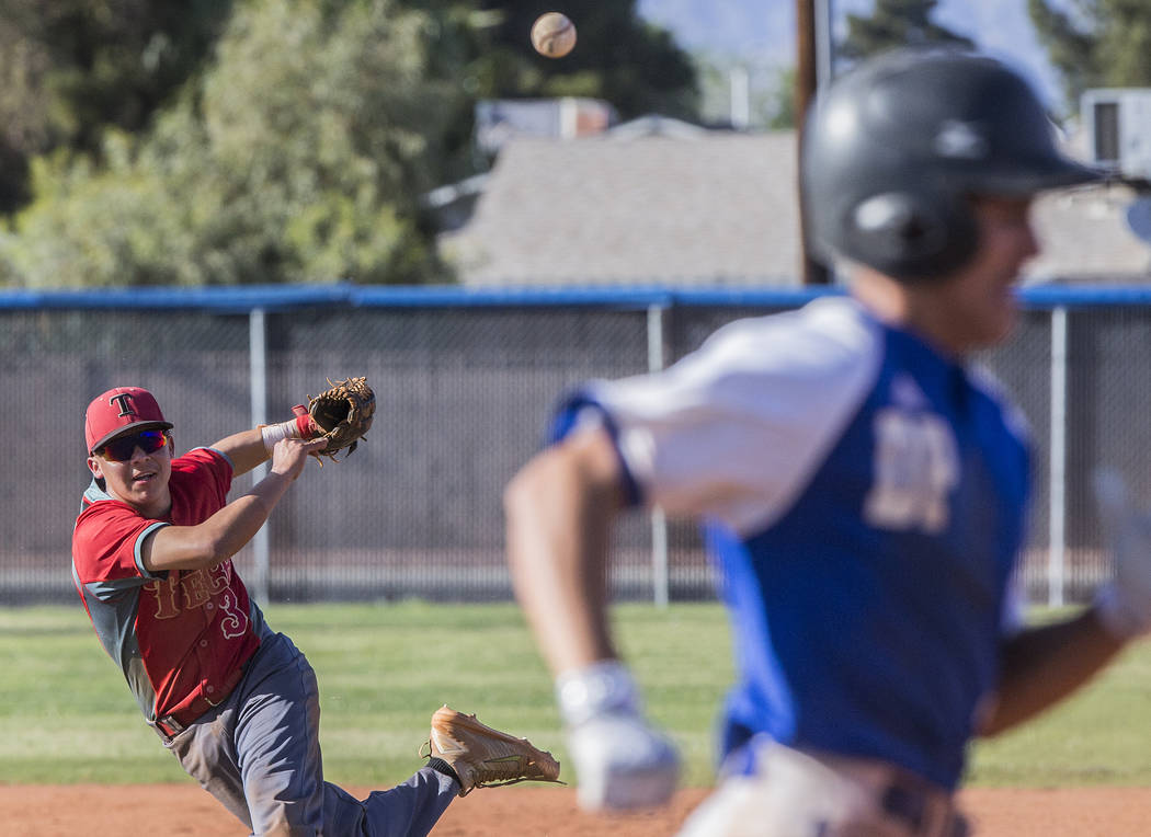 Southeast Career Tech sophomore shortstop Jose Leon (3) makes an acrobatic play to throw out a Desert Pines runner during the Roadrunners road matchup with the Jaguars on Tuesday, April 3, 2018, a ...