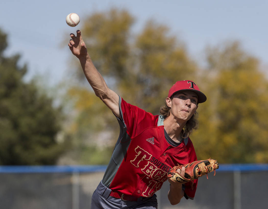 Southeast Career Tech senior pitcher Gabe Kermode (13) delivers to the plate during the Roadrunners road matchup with the Jaguars on Tuesday, April 3, 2018, at Desert Pines High School, in Las Veg ...