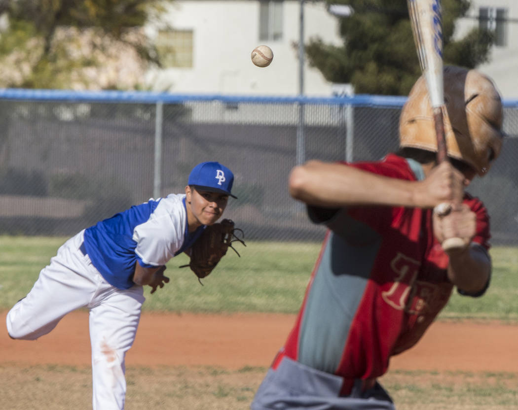 Desert Pines senior Salvador Becerra (23) delivers to the plate during the Jaguars Class 3A home matchup with Southeast Career Tech on Tuesday, April 3, 2018, at Desert Pines High School, in Las V ...