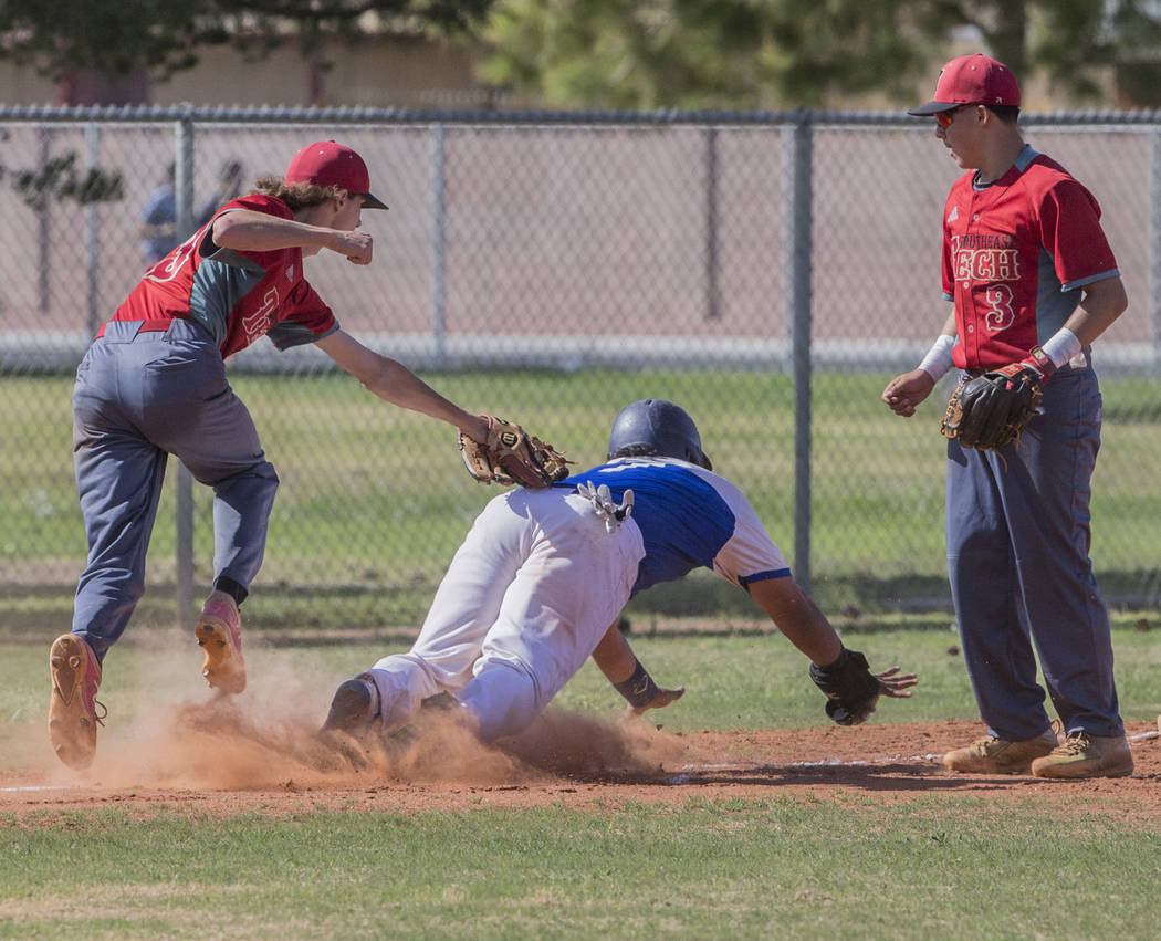 Desert Pines senior Juan Castaneda (7) is tagged out by Southeast Career Tech senior pitcher Gabe Kermode (13) during the Jaguars Class 3A home matchup with the Roadrunners on Tuesday, April 3, 20 ...