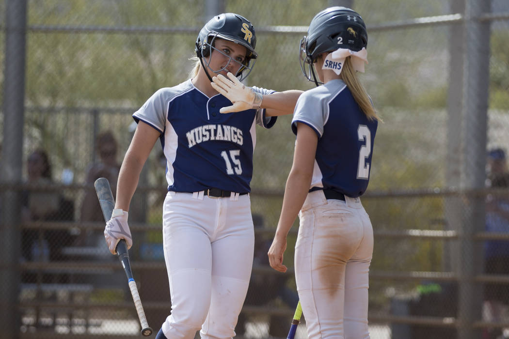 Shadow Ridge's Tori Nichols (15) Mia Voges celebrates her score with Raelyn Kendall (2) against El Camino Real during the first inning of the softball Spring Jamboree seventh-place game at Ma ...