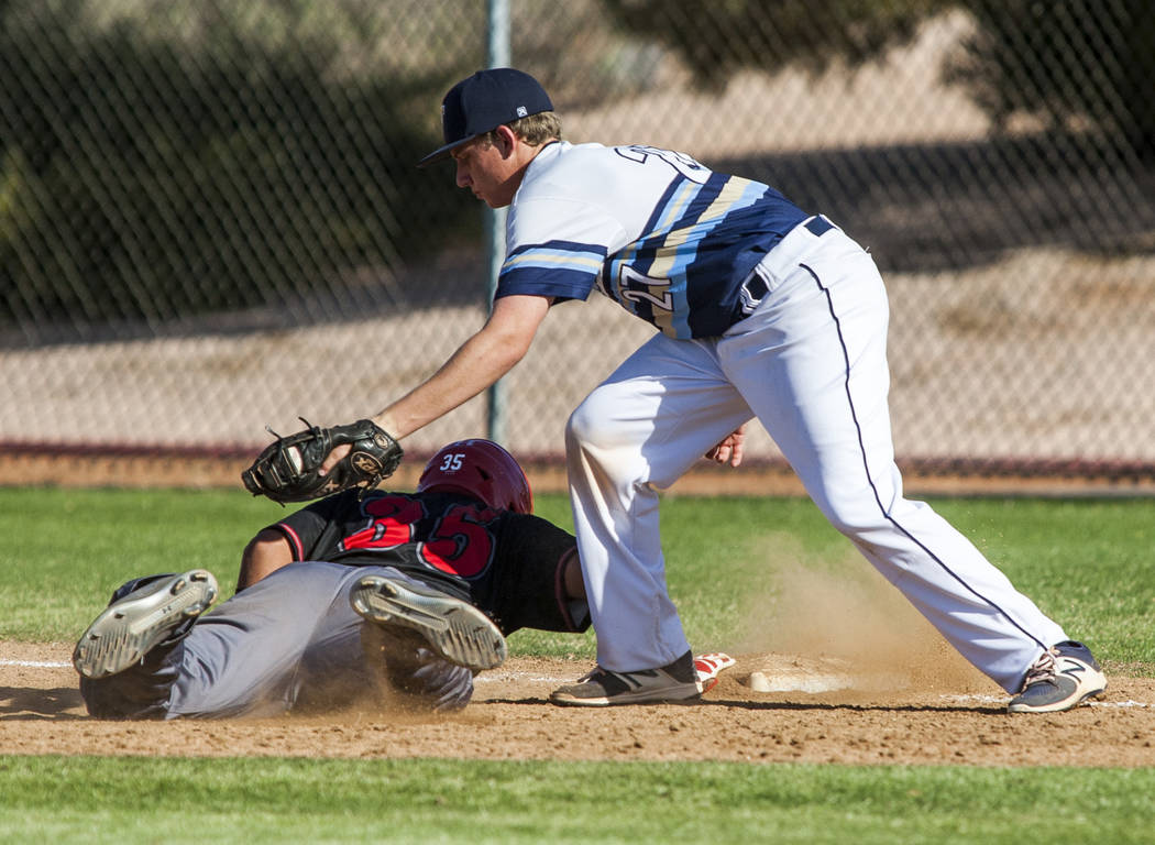 Las Vegas catcher Daniel Jimenez slides in safe at first while Foothill first baseman Tyler Kara tries to tag him out during the fourth inning at Foothill High School in Henderson on Wednesday, Ap ...