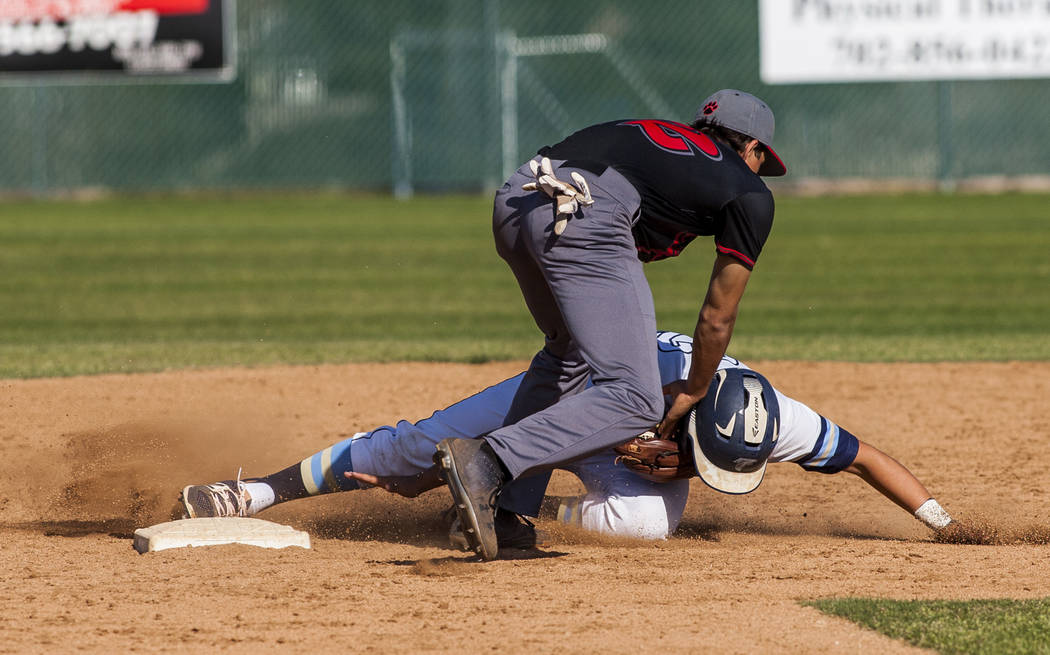 Las Vegas infielder Nathan Freimuth tags out Foothill's Jake Perales at second during the fourth inning at Foothill High School in Henderson on Wednesday, April 4, 2018. Foothill won 1-0.  Patrick ...