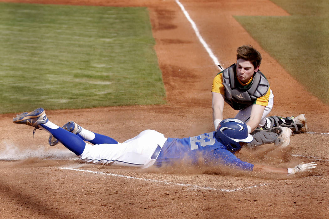 Bishop Gorman's second baseman Dutch Landis (22) is tagged out by Clearfield catcher Ethan Giacalone at home as attempting to score on a sacrifice fly during the third inning at Bishop Gorman High ...