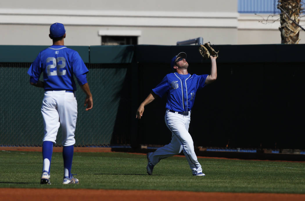 Bishop Gorman's outfielder Max Prescott (11) catches a fly ball against Clearfield at Bishop Gorman High School in Las Vegas on Thursday, April 5, 2018. Andrea Cornejo Las Vegas Review-Journal @dr ...