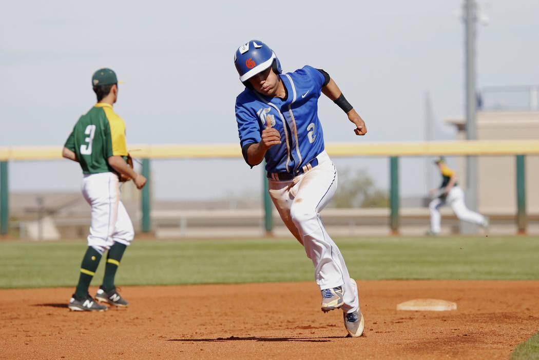 Bishop Gorman's shortstop Tyler Curtis (2) runs towards third base against Clearfield at Bishop Gorman High School in Las Vegas on Thursday, April 5, 2018. Andrea Cornejo Las Vegas Review-Journal  ...