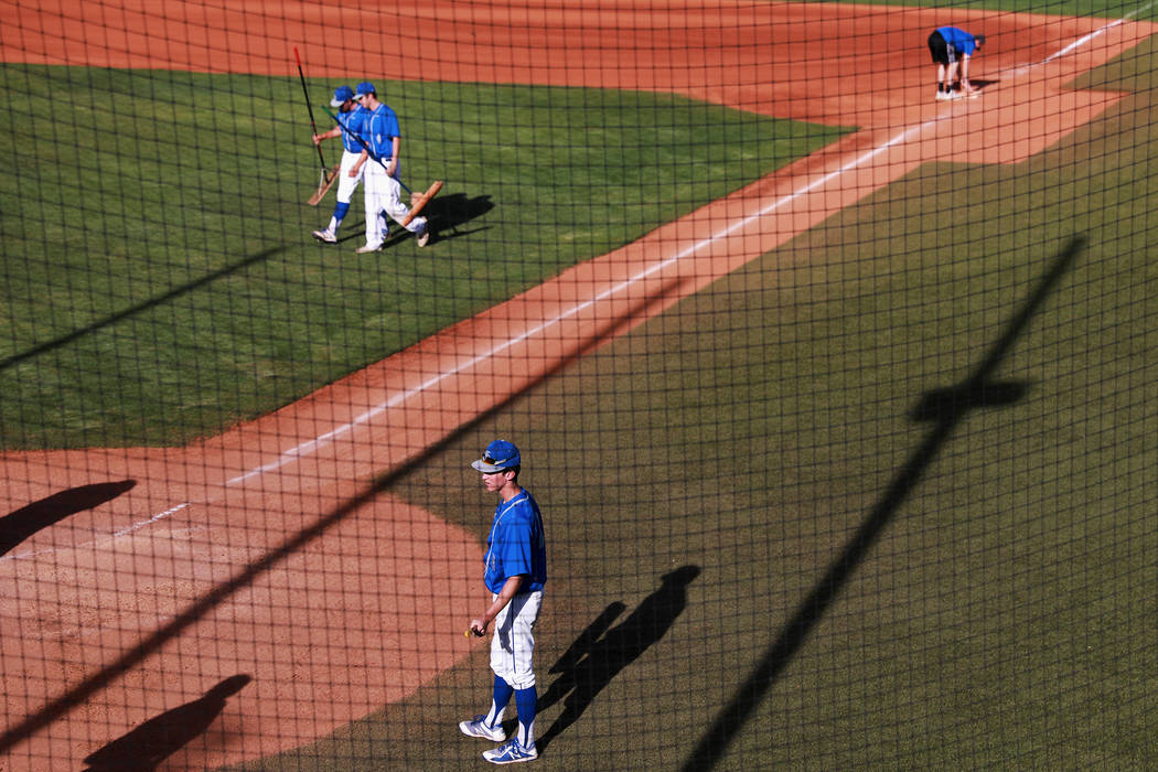 Bishop Gorman's baseball team sweeps the field after being defeated by Clearfield at Bishop Gorman High School in Las Vegas on Thursday, April 5, 2018. Andrea Cornejo Las Vegas Review-Journal @dre ...