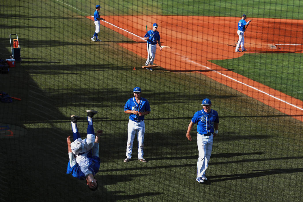 Bishop Gorman's baseball team hangs out after being defeated by Clearfield at Bishop Gorman High School in Las Vegas on Thursday, April 5, 2018. Andrea Cornejo Las Vegas Review-Journal @dreacornejo