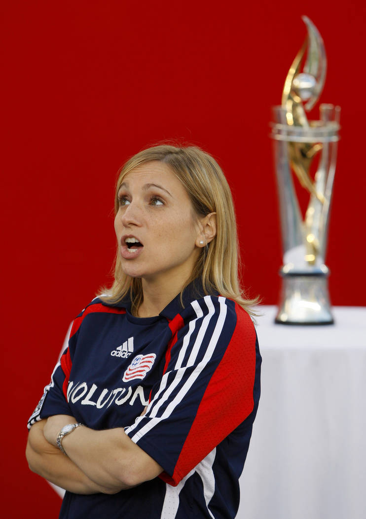 Kerri Strug, 1996  USA Olympic gold medal gymnast, stands near the SuperLiga championship trophy won by the New England Revolution before the start of their MLS soccer match against the Chicago Fi ...