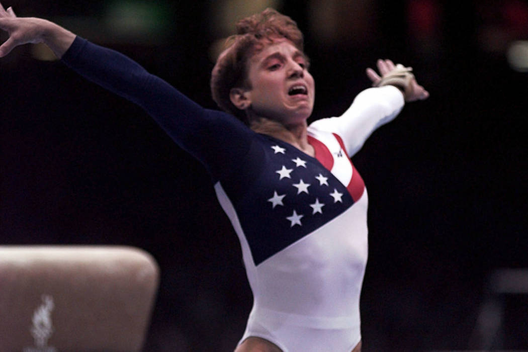Kerri Strug, of Houston, Texas, reacts after badly landing on her left leg following her vault routine at the women's team gymnastics competition at the Centennial Summer Olympic Games in Atlanta  ...