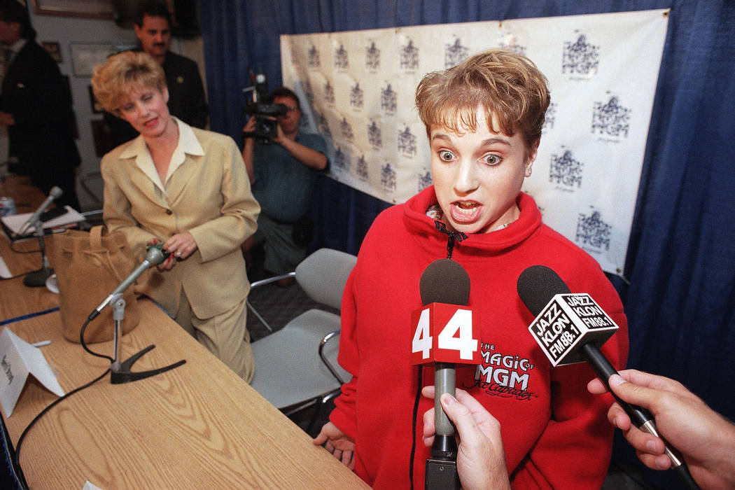 Kerri Strug of the 1996 Gold Medal-winning U.S. Olympic gymnastics team talks with reporters on Thursday, Sept. 12, 1996 in Los Angeles, after announcing her participation in The Magic of MGM, an  ...