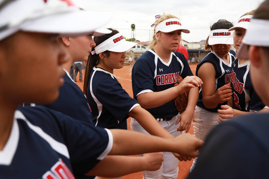 Coronado gathers for a team huddle during the fourth inning against Basic at Basic High School in Henderson on Friday, April 6, 2018. Basic won 4-3. Andrea Cornejo Las Vegas Review-Journal @dreaco ...