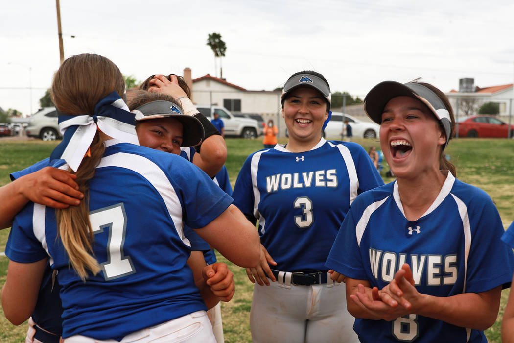 From left, Basic's Shelby Basso (7), Mikayla Berg (15), Adalena Clayton (3) and Hannah Barr (8) cheer after their team defeated Coronado at Basic High School in Henderson on Friday, April 6, 2018. ...
