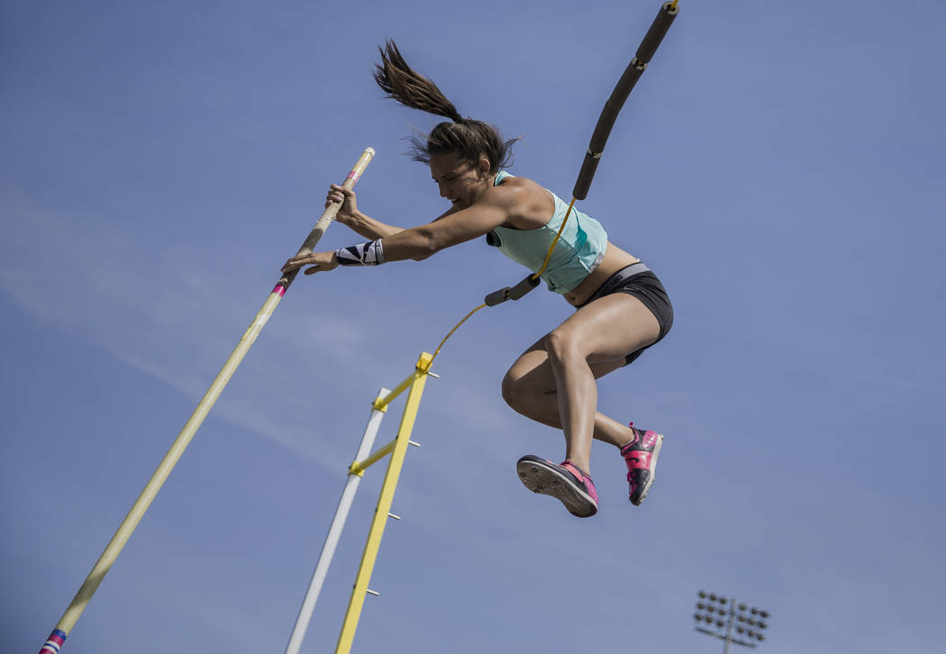 "Gabby Carson, one of Nevada's top prep pole vaulters, works on her ""fly-away"" technique during practice on Monday, April 9, 2018, at Liberty High School, in Las Vegas.  Benjamin Hager La ..."