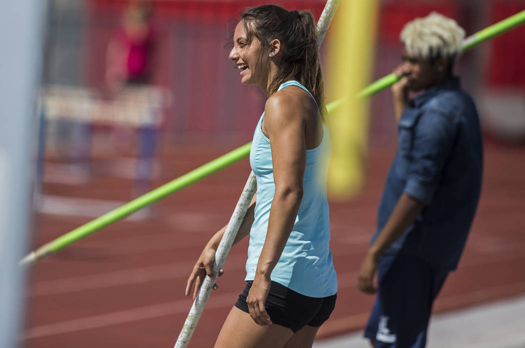 Gabby Carson, left, one of Nevada's top prep pole vaulters, jokes around with teammates during practice on Monday, April 9, 2018, at Liberty High School, in Las Vegas.  Benjamin Hager Las Vegas Re ...