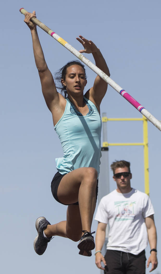 Gabby Carson, left, one of Nevada's top prep pole vaulters, works on her technique during practice on Monday, April 9, 2018, at Liberty High School, in Las Vegas.  Benjamin Hager Las Vegas Review- ...