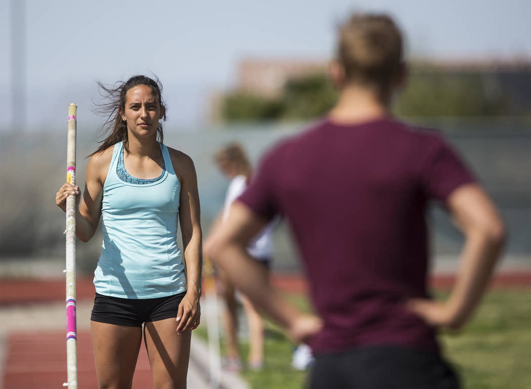 Gabby Carson, left, one of Nevada's top prep pole vaulters, waits to make a jump during practice on Monday, April 9, 2018, at Liberty High School, in Las Vegas.  Benjamin Hager Las Vegas Review-Jo ...