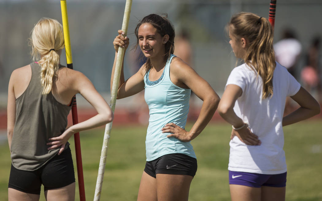 Gabby Carson, middle, one of Nevada's top prep pole vaulters, talks with teammates during practice on Monday, April 9, 2018, at Liberty High School, in Las Vegas.  Benjamin Hager Las Vegas Review- ...
