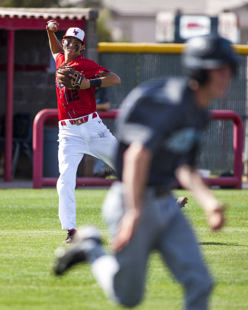 Las Vegas third baseman Nathan Freimuth looks for a play at first while playing against Silverado in the second inning at Las Vegas High School on Tuesday, April 10, 2018. Las Vegas won 4-3 in the ...