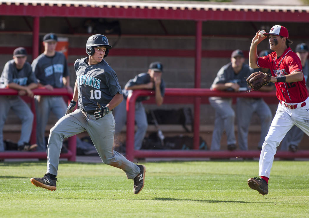Las Vegas third baseman chases after Silverado's Nikolas Cortez, trapping him between third and home during the fourth inning at Las Vegas High School on Tuesday, April 10, 2018. Las Vegas won 4-3 ...