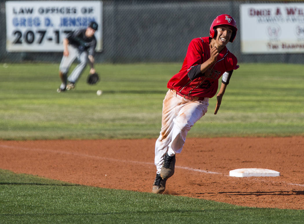 Las Vegas pitcher Osvaldo Bernabee runs toward home and scores against Silverado during the fifth inning at Las Vegas High School on Tuesday, April 10, 2018. Las Vegas won 4-3 in the eighth inning ...