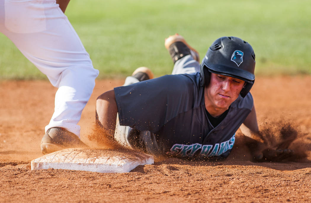Silverado's Nikolas Cortez slides in safe at first during the sixth inning at Las Vegas High School on Tuesday, April 10, 2018. Las Vegas won 4-3 in the eighth inning.  Patrick Connolly Las Vegas  ...