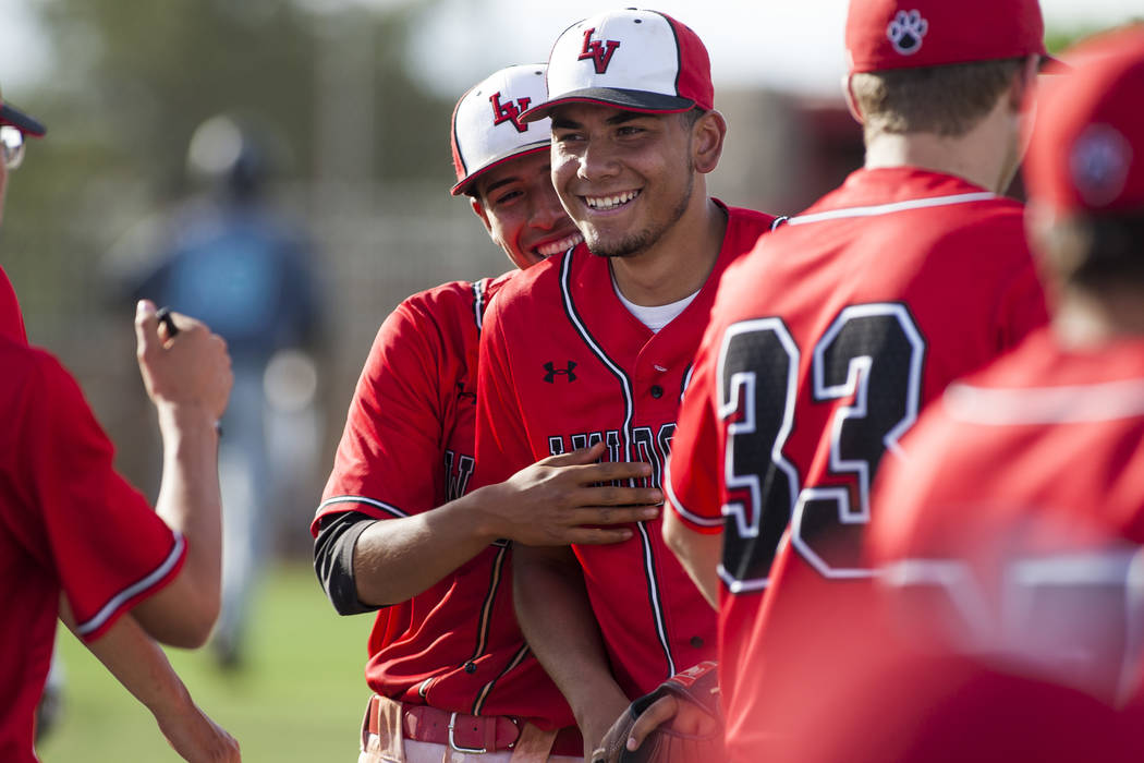 Las Vegas players celebrate in between the sixth and seventh inning while playing against Silverado at Las Vegas High School on Tuesday, April 10, 2018. Las Vegas won 4-3 in the eighth inning.  Pa ...