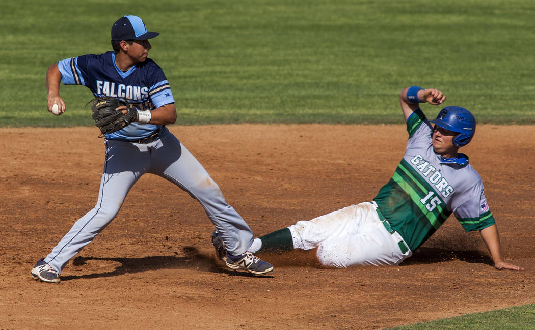 Green Valley's Jake Empey tries to slide into second but Foothill's Jake Perales had already tagged the base at Green Valley High School on Thursday, April 12, 2018. Green Valley won 5-3. Patrick ...