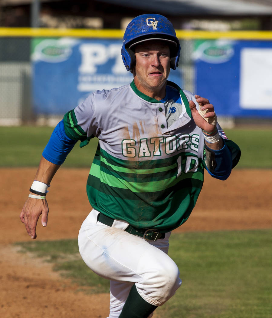 Green Valley's Carter Gehlken runs toward third base while playing against Foothill in the fifth inning at Green Valley High School on Thursday, April 12, 2018. Green Valley won 5-3. Patrick Conn ...