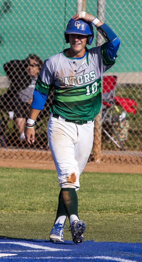 Green Valley's Carter Gehlken reacts after scoring while playing against Foothill in the fifth inning at Green Valley High School on Thursday, April 12, 2018. Green Valley won 5-3. Patrick Connol ...