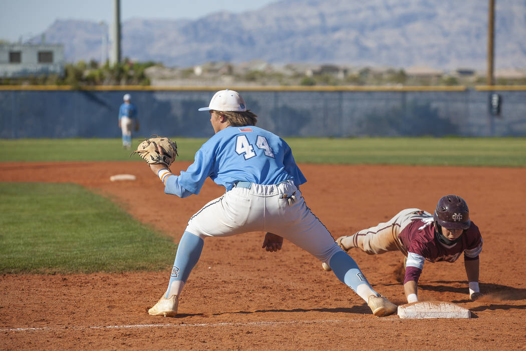 Centennial High School's Kris Bow (44) tries to tag out Cimarron-Memorial High School's Cameron Stafford (5) in a game at Centennial High School in Las Vegas, Friday, April 13, 2018. Rachel Aston ...