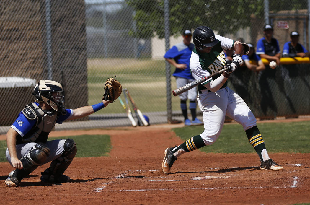 Rancho's shortstop Edarian Williams (32) swings against Basic at Rancho High School in Las Vegas on Saturday, April 7, 2018. Rancho won 16-4. Andrea Cornejo Las Vegas Review-Journal @dreacornejo