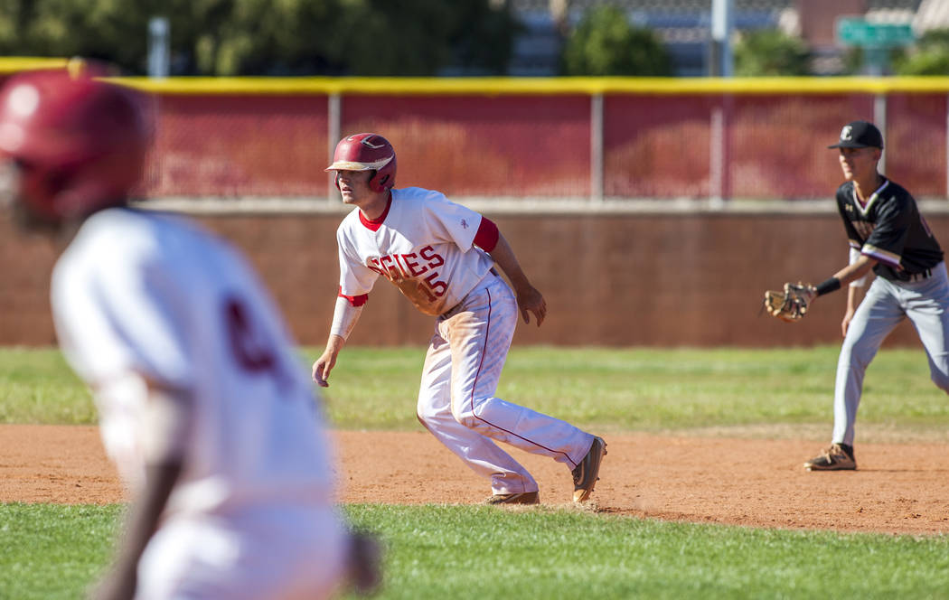 Arbor View infielder Bradley Stone, center, leads off from second base during the fourth inning while playing against Faith Lutheran at Arbor View High School in Las Vegas on Tuesday, April 17, 20 ...