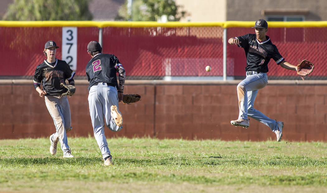 Faith Lutheran players, from left, Brayden Palluck, Michael Rice and Dylan Schafer scramble for the ball while playing against Arbor View in the fifth inning at Arbor View High School in Las Vega ...