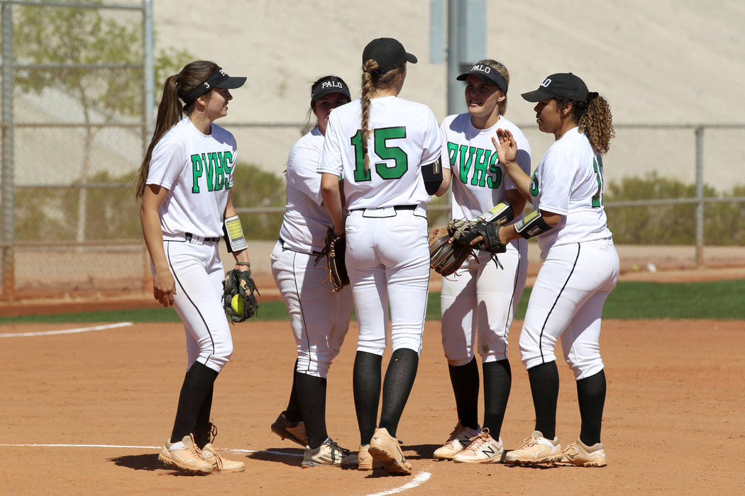 Palo Verde players gather on the mound in the first inning of their softball game against San Diego during the Spring Jamboree at Majestic Park in Las Vegas Friday, March 30, 2018. Palo Verde won ...