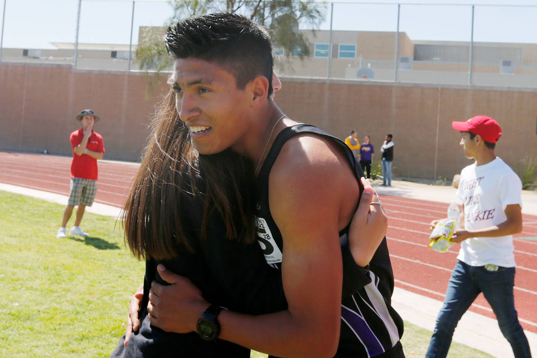 Silverado senior runner Omar Aguilar-Espinoza (5) hugs his teammate Ashley Nekoba after winning in the boys' 1600m during Blaine Thompson-Las Vegas Track Classic at Desert Oasis High School in Las ...